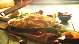 Warm colors footage: hard cheese is grated on the beautiful plate of fresh pappardelle