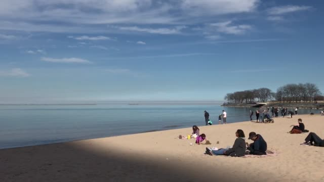 warm february temperatures have caused chicagoans to take to the lakefront some even donning bathing suits as they soak up the sun and beautiful... - lakeshore stock videos and b-roll footage