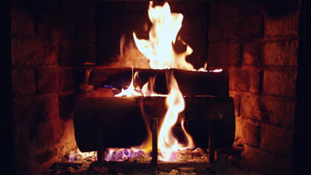 warm fire burning in a domestic fireplace - fireplace stock videos & royalty-free footage