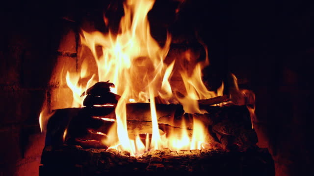 warm fire burning in a domestic fireplace - open fire stock videos & royalty-free footage