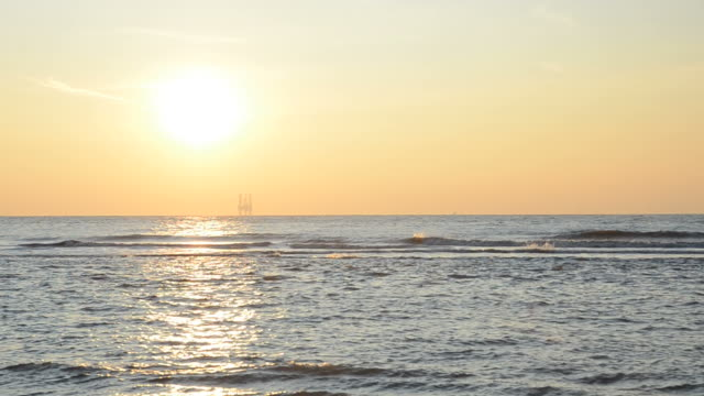 warm sunset minutes on the sea - oil exploration platform stock videos & royalty-free footage