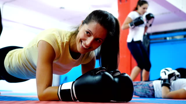 warm up exercises for start of the training - kickboxing stock videos and b-roll footage