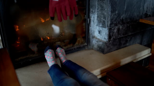 warming feet by fireplace - log fire stock videos & royalty-free footage