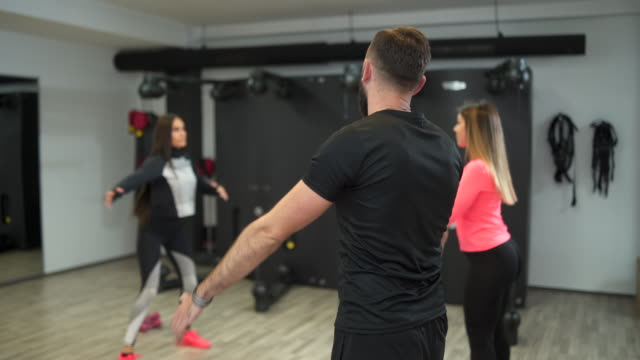 warming up before our training - cross trainer stock videos & royalty-free footage