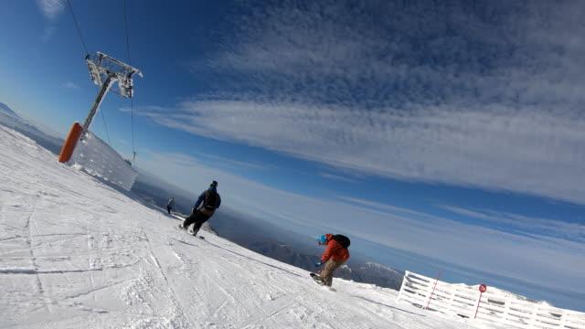 warming up down to ski slopes - alpine skiing stock videos & royalty-free footage