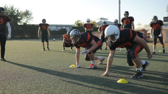 warming up in american football - headwear stock videos & royalty-free footage