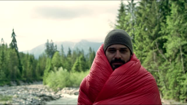 warming up with sleeping bag. springtime in mountains - blanket stock videos and b-roll footage