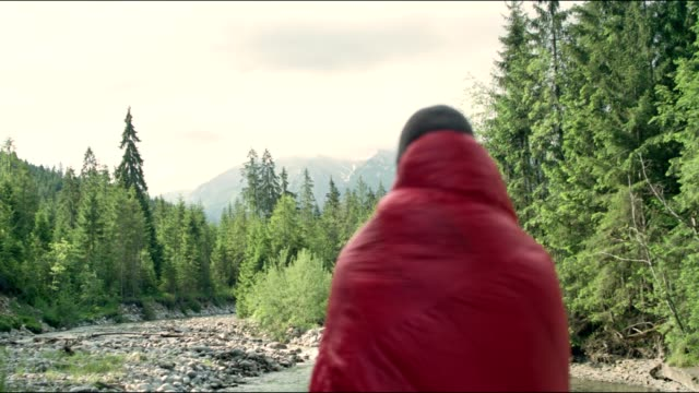 warming up with sleeping bag. springtime in mountains - blanket background stock videos & royalty-free footage