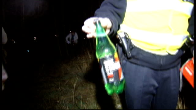 bma warning about alcohol consumption lib linlithgow bottle of cider shown to camera by police officer - linlithgow stock videos and b-roll footage