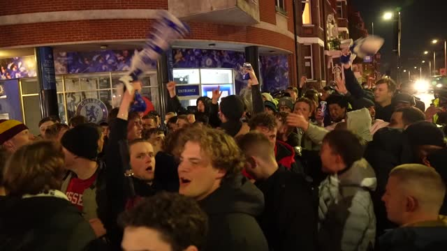 contains strong language.* fans celebrate outside stamford bridge after chelsea won against real madrid and reached the champions league final. - danger stock videos & royalty-free footage