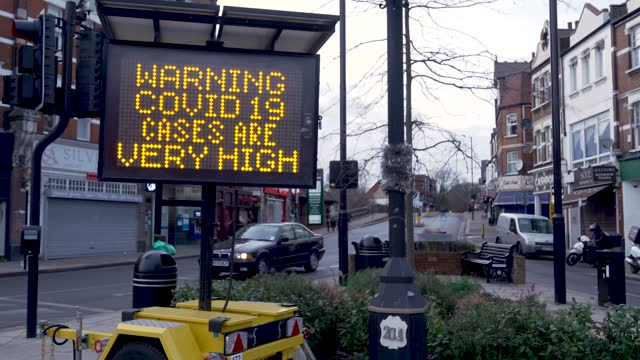 warning covid cases are very high' message on a electronic board in palmers green, as england is going through its 3rd national lockdown. as the uk... - quarantine stock videos & royalty-free footage