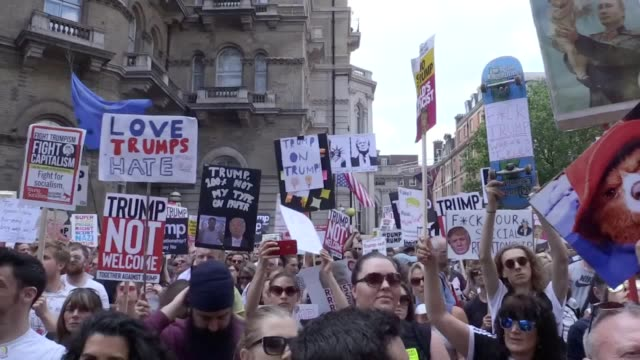 Footage contains offensive language Hundreds of protesters gather outside Portland Place to start a march across London against President Donald...