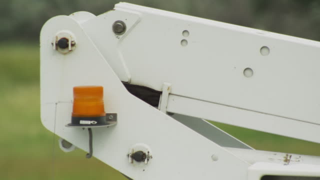 warning light flashes on the boom of a lift bucket or cherry picker. - cherry picker stock videos & royalty-free footage