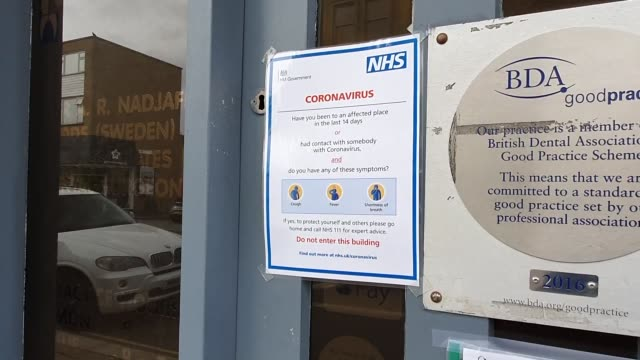 a warning poster seen on the door of a dentists during the coronavirus pandemic in east dulwich on march 17 2020 in london england - brian dayle coronavirus stock videos & royalty-free footage