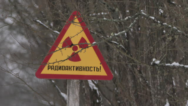 warning radiation sign on winter road, belarus - nuclear fallout stock videos & royalty-free footage
