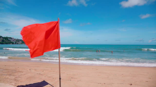 warning red flag on the beach,phuket - flag blowing in the wind stock videos & royalty-free footage