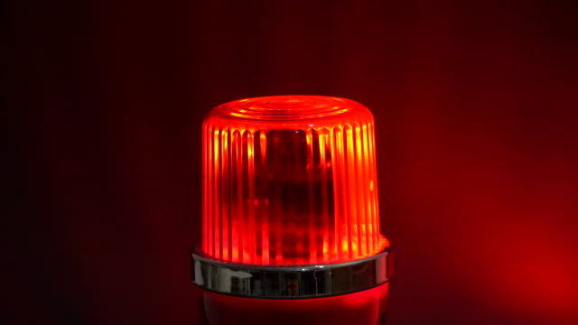 warning rotating red siren flashing lights - strobe light stock videos & royalty-free footage