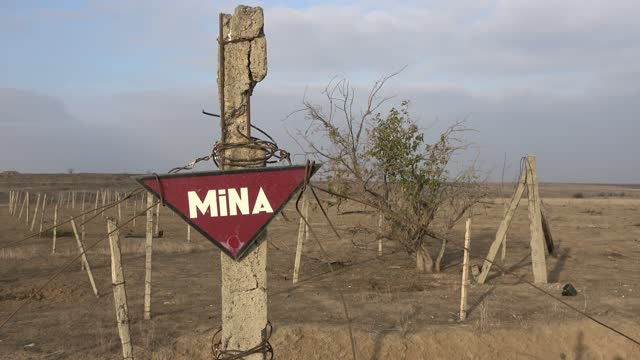 warning sign in a minefield near the town of agdam on december 2020, in agdam, azerbaijan. the town of agdam and its surrounding district were... - 14 15 years stock videos & royalty-free footage