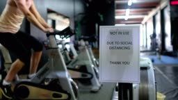 COVID warning signage in a gym