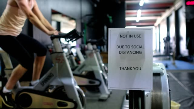 covid warning signage in a gym - health club stock videos & royalty-free footage