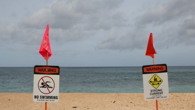 warning signs on sunset beach north shore oahu hawaii - drowning stock videos & royalty-free footage
