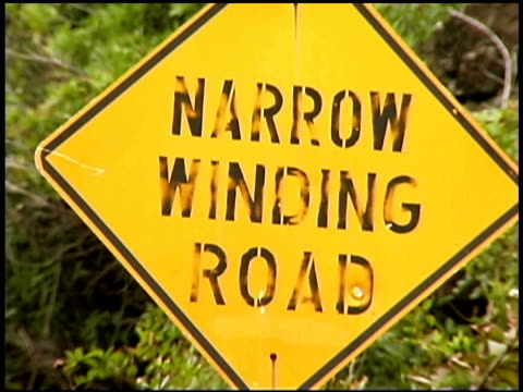 warning winding road caution sign - western script stock videos & royalty-free footage