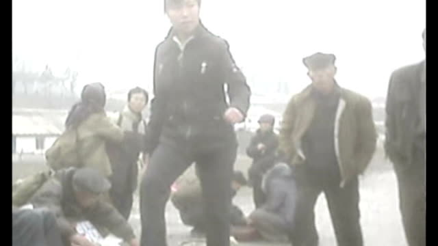 UN warns Kim Jongun over torture and mass killings File / Date Unknown SECRET FILMING of poor people searching on ground for food