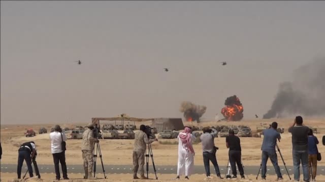 warplanes roared overhead tanks rumbled across the desert and smoke filled the sky thursday for the final day of what saudi arabia billed as the... - militärövning bildbanksvideor och videomaterial från bakom kulisserna