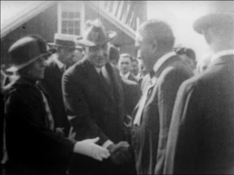 warren g harding with florence harding removing hat shaking hands / alaska / newsreel - 1923 stock videos & royalty-free footage