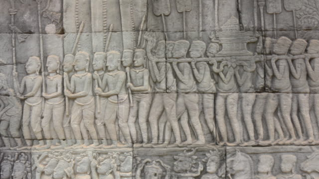 pan / warrior on bas-relief on wall at bayon temple - bas relief stock videos & royalty-free footage