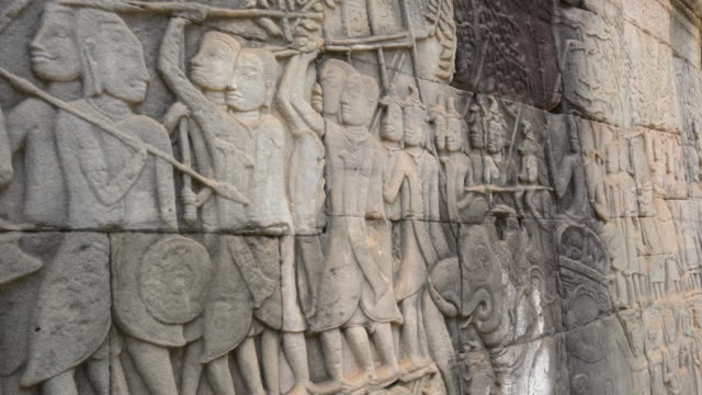 pov / warrior on bas-relief on wall at bayon temple - monument stock videos & royalty-free footage