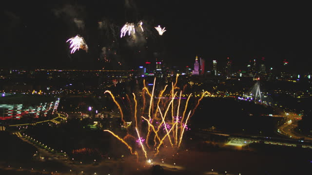 warsaw panorama on new year's eve. firework displays seen from drone - eastern european culture stock videos & royalty-free footage