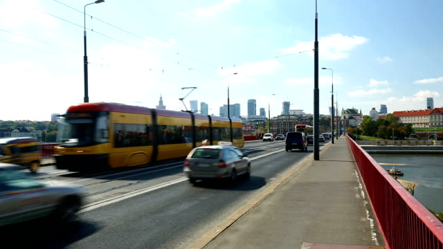 warsaw with bridge and traffic - warschau stock videos and b-roll footage