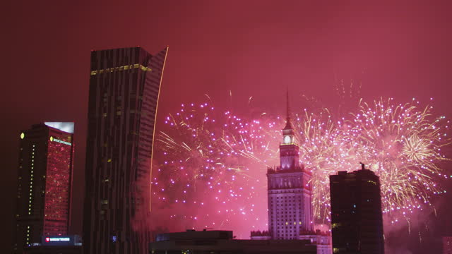 warsaw's new years eve. palace of culture and science with fireworks in background. drone view - eastern european culture stock videos & royalty-free footage
