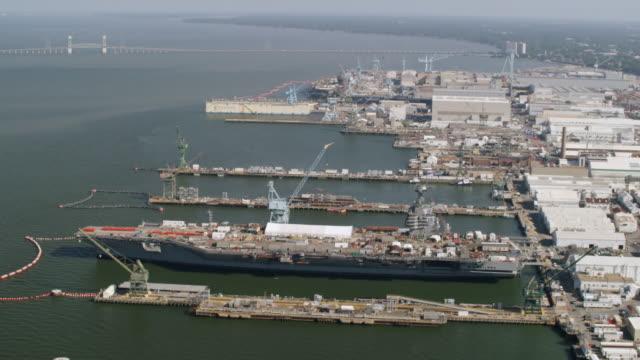 ws zo aerial pov warship moored near docks / virginia, united states - warship stock videos & royalty-free footage