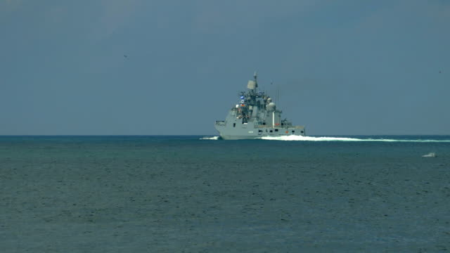 warship on the horizon in the sea - warship stock videos & royalty-free footage