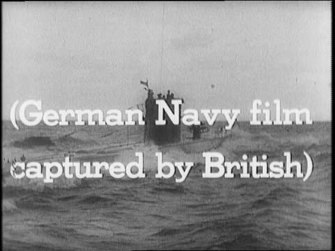 Warships in open water / Nazi using binoculars to see US warship / German seamen descend into submarine / UBoat descends under water / submarine...