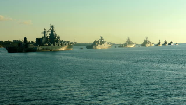 warships in the bay at anchor in the parade