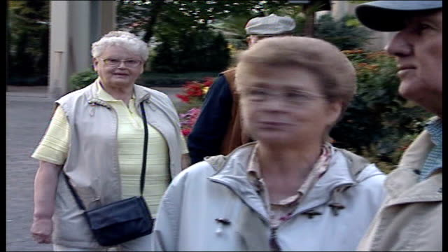 wartime children's mass grave discovered locals talking to moore local resident speaking to moore sot - mass grave stock videos and b-roll footage