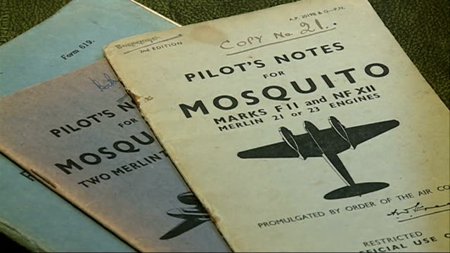 stockvideo's en b-roll-footage met wartime fighter pilot auctions medals to pay for care home; medals 'pilot' notes for mosquito book erskine-hill interview sot - pilot