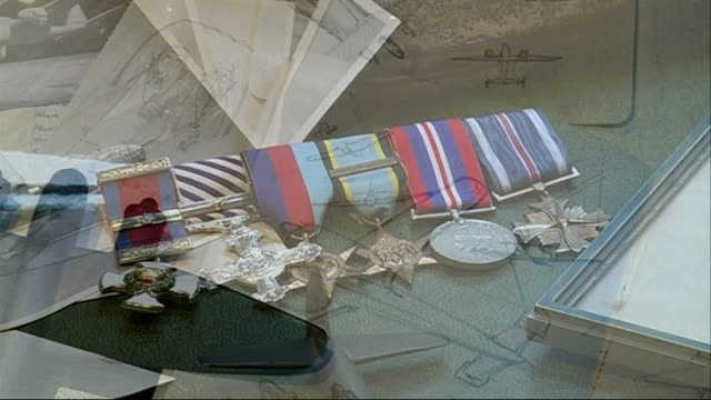 wartime fighter pilot auctions medals to pay for care home sketches of planes medals with other memorabilia pull out - お土産点の映像素材/bロール