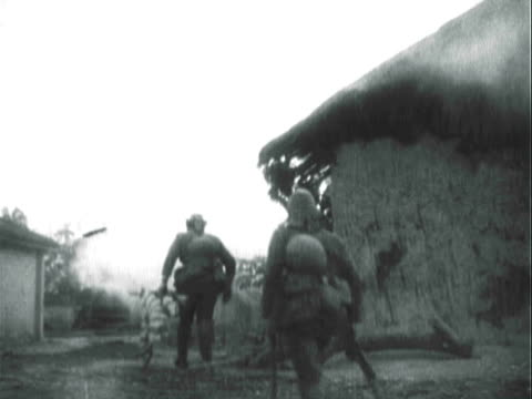 montage wartime footage from japanese invasions, including casualty pictures and the newspaper headlines / manchuria, china - guerra del pacifico video stock e b–roll