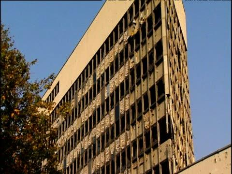 war-torn office block with blown out windows mostar - office block exterior stock-videos und b-roll-filmmaterial