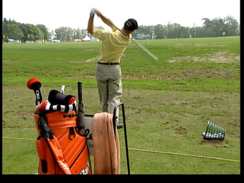warwickshire the belfry cs new controversial 'erc' driver held by golfer freeze frame graphic composition of club side golfers in line practicing... - golf bag stock videos and b-roll footage