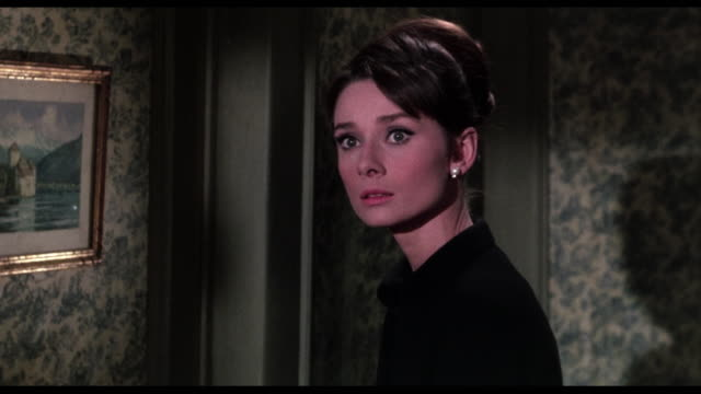 1963 wary woman (audrey hepburn) receives warning phone call losing trust in cary grant - audrey hepburn stock videos & royalty-free footage