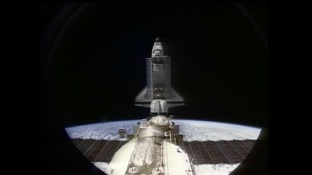 sts63 was the first mission of the us/russian shuttlemir program which carried out the first rendezvous of the american space shuttle with russia's... - mir space station stock-videos und b-roll-filmmaterial