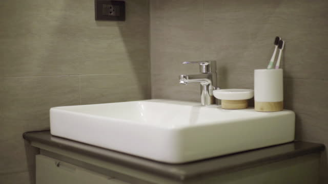 wash basin in the bathroom - toothbrush stock videos & royalty-free footage