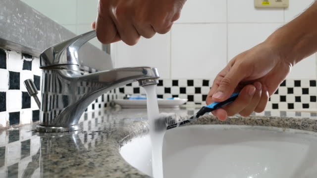 washing a toothbrush. - brushing teeth stock videos & royalty-free footage