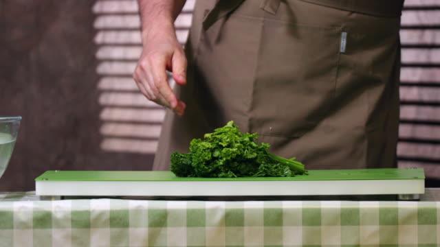 Washing and chopping parsley.
