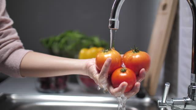 washing and preparing vegetables - lavandino video stock e b–roll